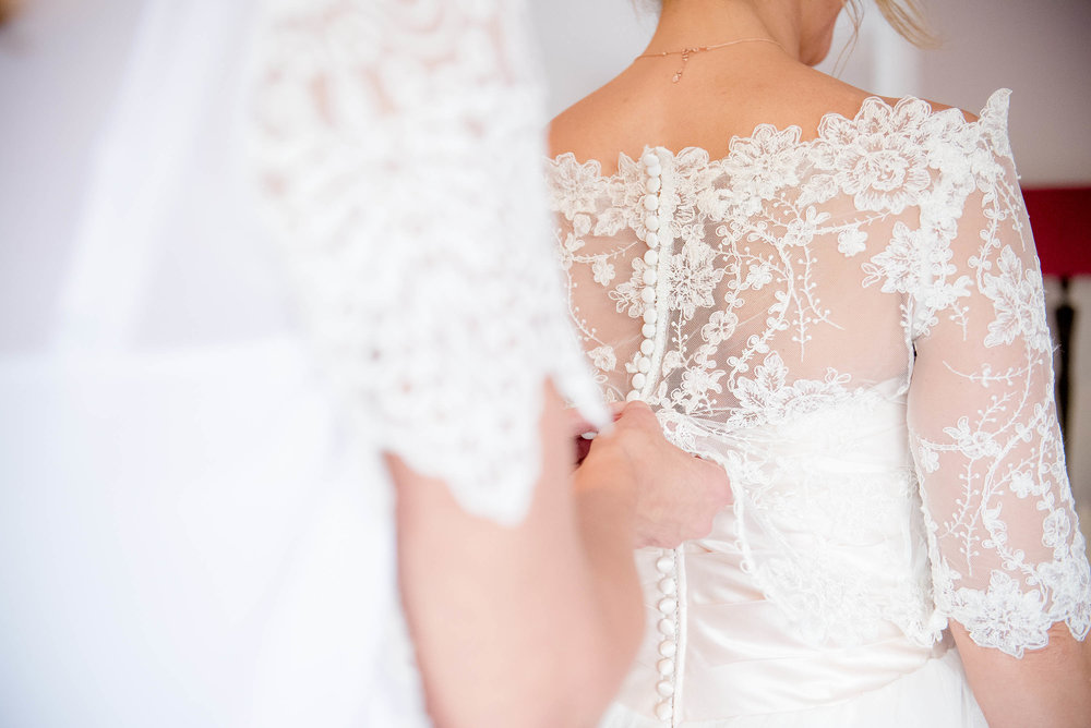 Lace dress being buttoned