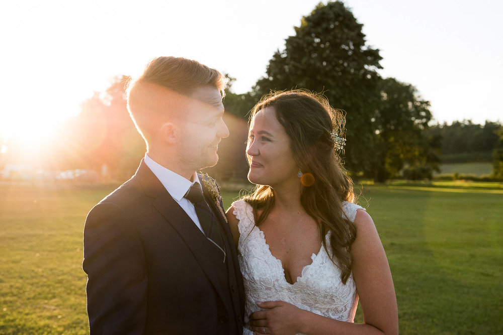 Sunset portrait of a bride and groom.jpg