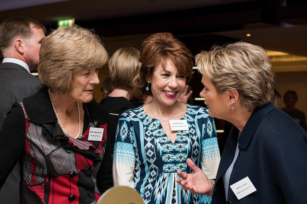 Kathy Lette chatting with Women of The Year Members at an event.jpg
