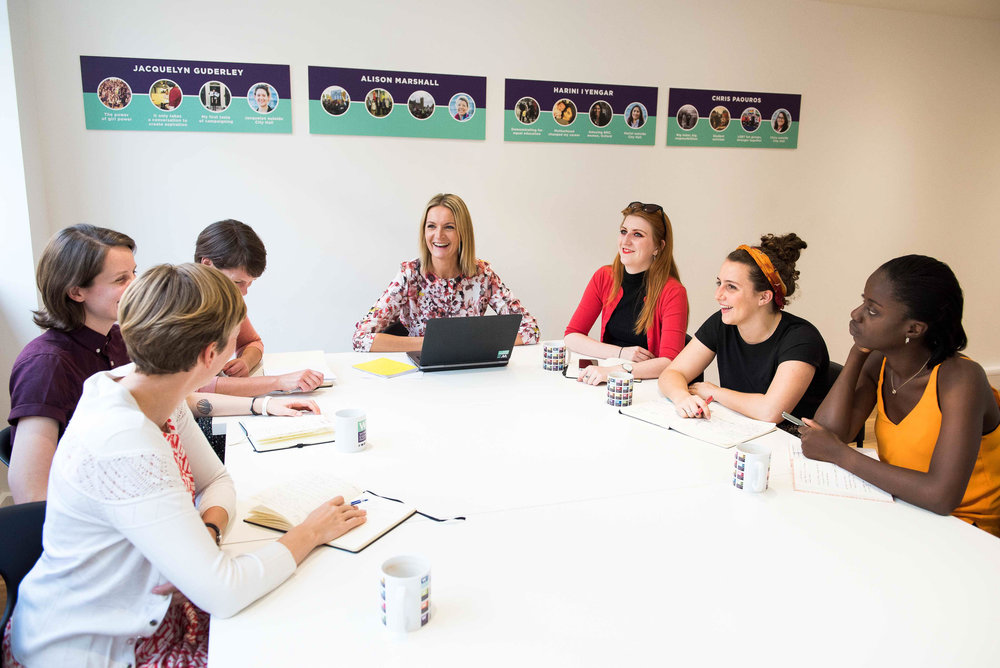 Women in an office setting chatting.jpg