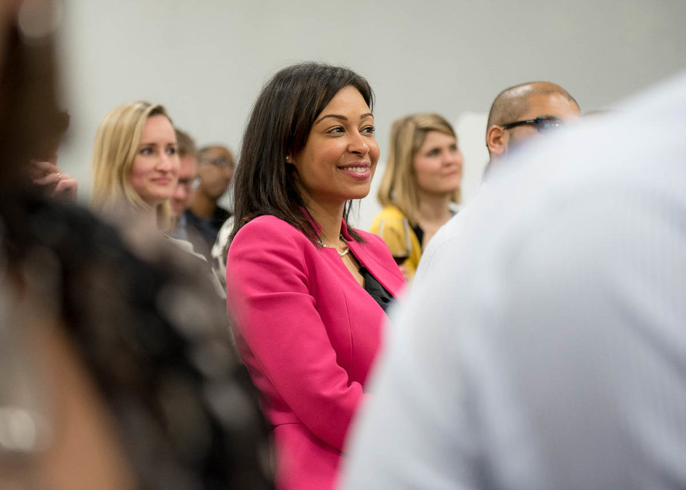 Women smiling in an audience.jpg