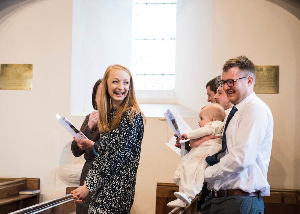 Giggling in church, A Day In The Life photography christening