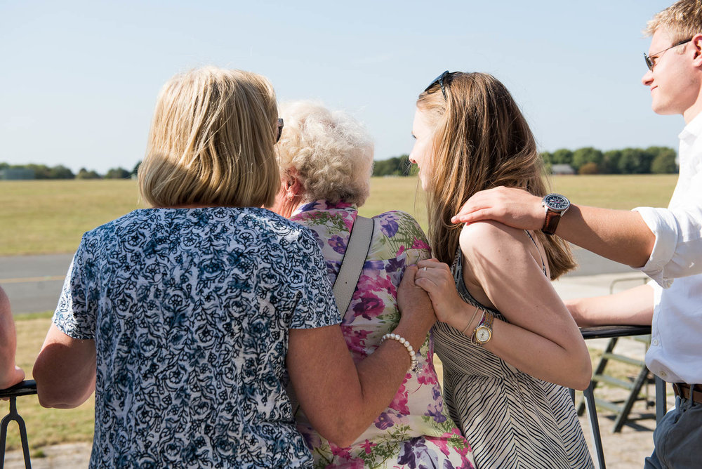 An emotional moment between three generations