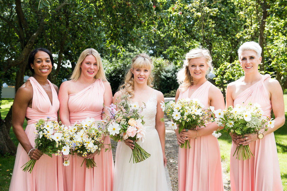Beautiful wild flower bouquets and pastel pink dresses at Dodmoor House. © Jessica Grace Photography