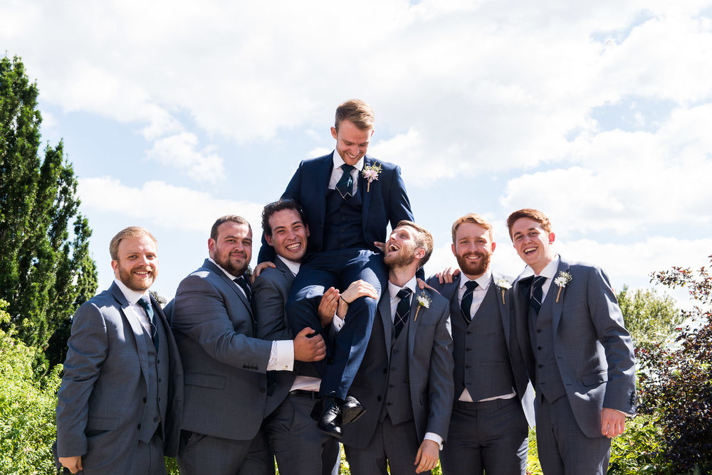 Groom on the shoulders of the groomsmen, Loseley Park, Surrey wedding photographer © Jessica Grace Photography
