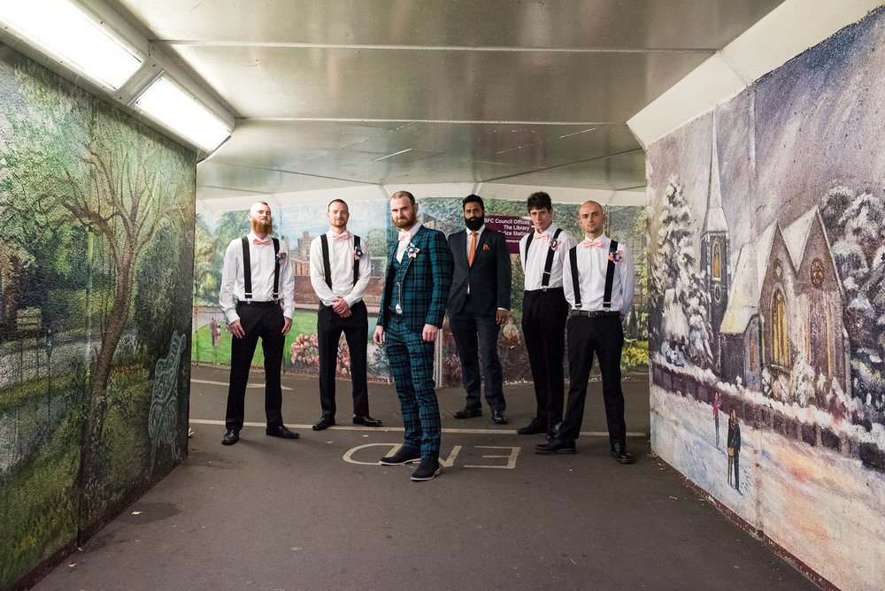 Alternative groomsmen portraits in subway with graffiti © Jessica Grace Photography