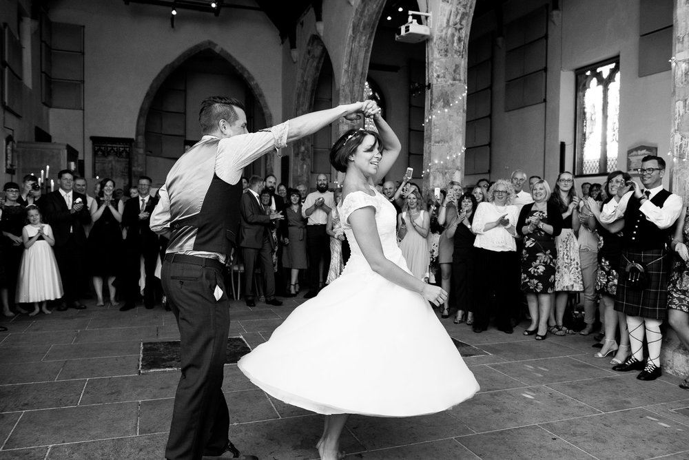 Black and white photograph of a couples first dance.