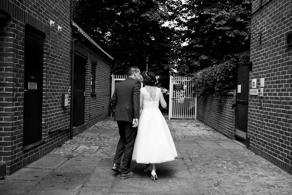 Stealing a moment together, the bride and groom walking in to the reception. © Jessica Grace Photography