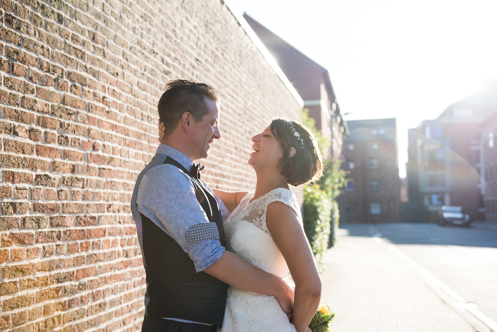 Relaxed portrait of bride and groom laughing together. York Wedding. © Jessica Grace Photography