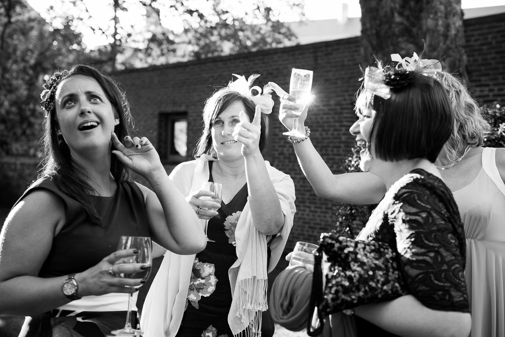 Captured Moment - joyous wedding guests having fun at the reception. York wedding. © Jessica Grace Photography