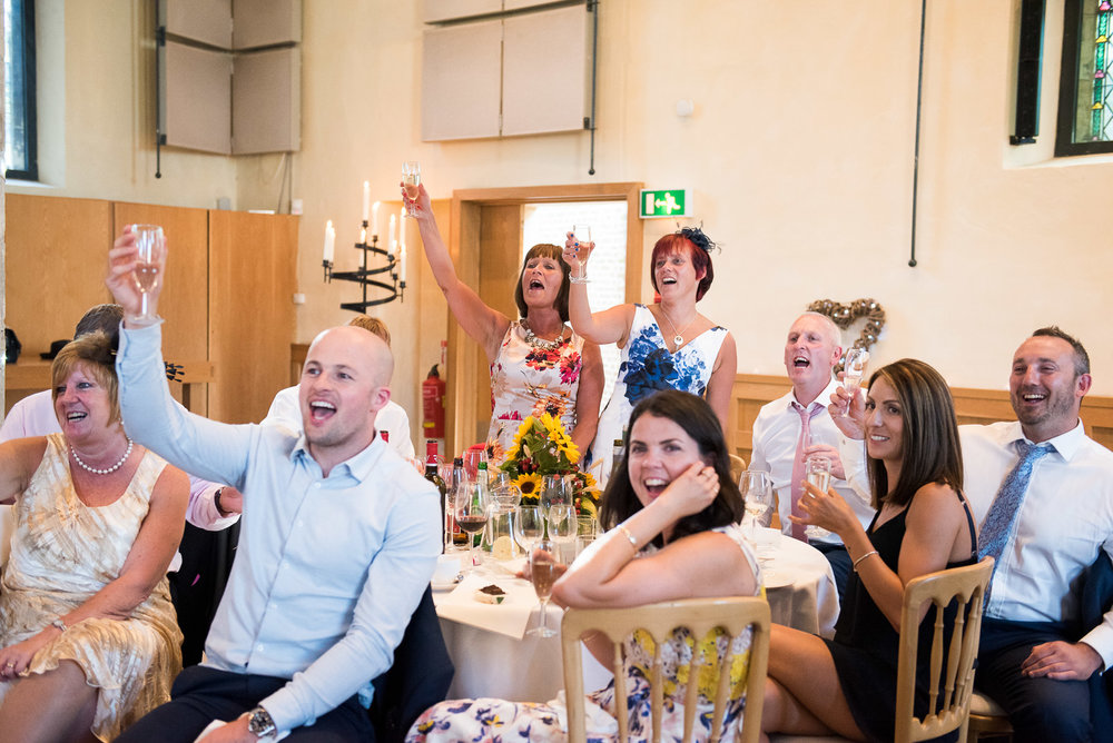 Fun and lively champagne toast to the bride and groom, York wedding. © Jessica Grace Photography