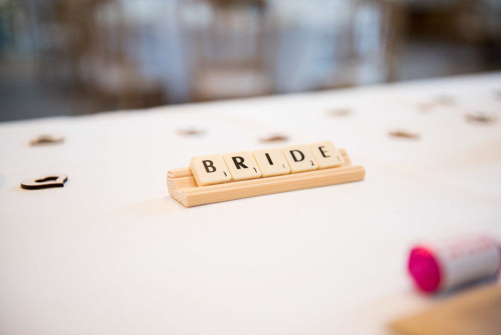 DIY scrabble tile place setting, with rustic wooden heart details.