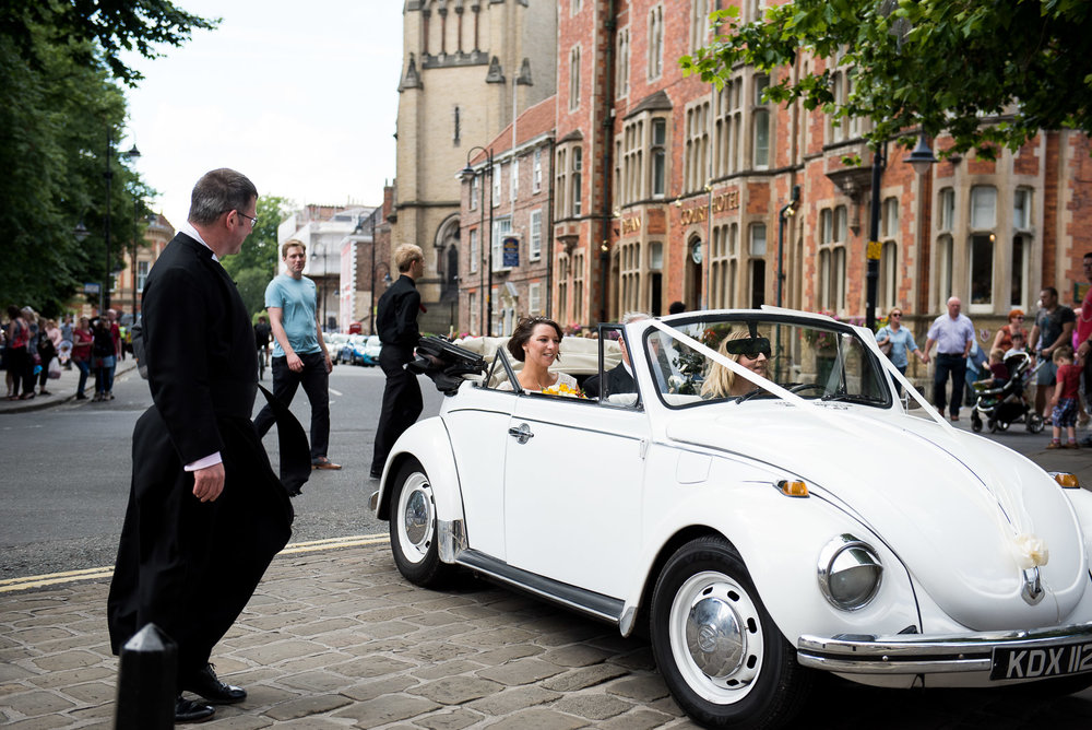 The bride arriving in a VW Beetle.jpg