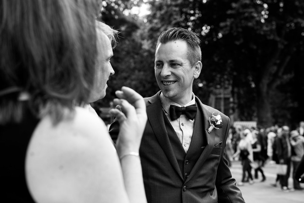 Handsome groom, with bow tie and Hugo Boss suit. © Jessica Grace Photography