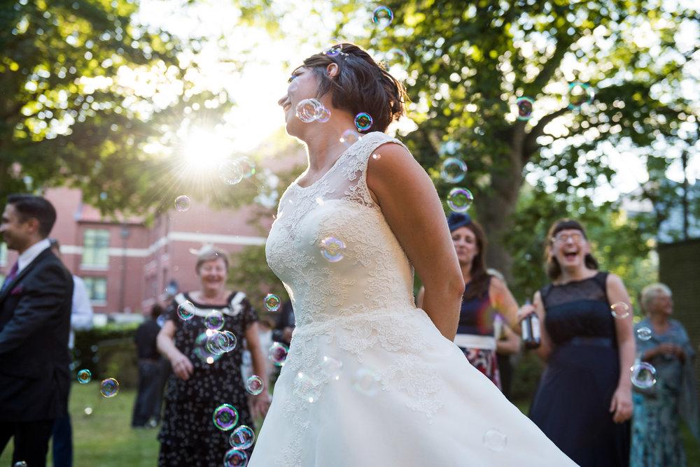 Beautiful bride dancing in the garden, York wedding. © Jessica Grace Photography