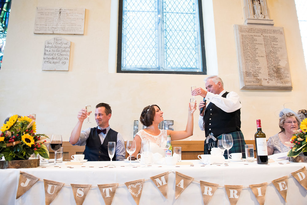 Champagne toast at fun York wedding. Yorkshire wedding photographer © Jessica Grace Photography