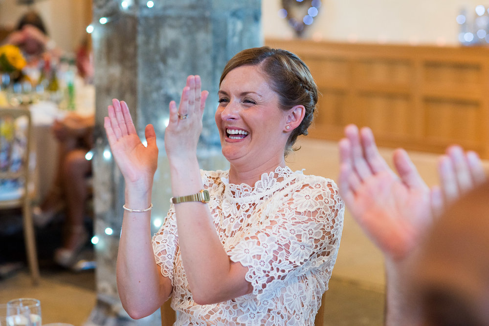 Fun reactions to wedding speeches. © Jessica Grace Photography