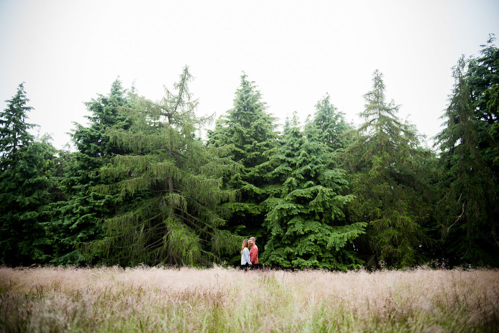 Couples engagement shoot, sharing a cuddle in a wooded field, Surrey UK © Jessica Grace Photography