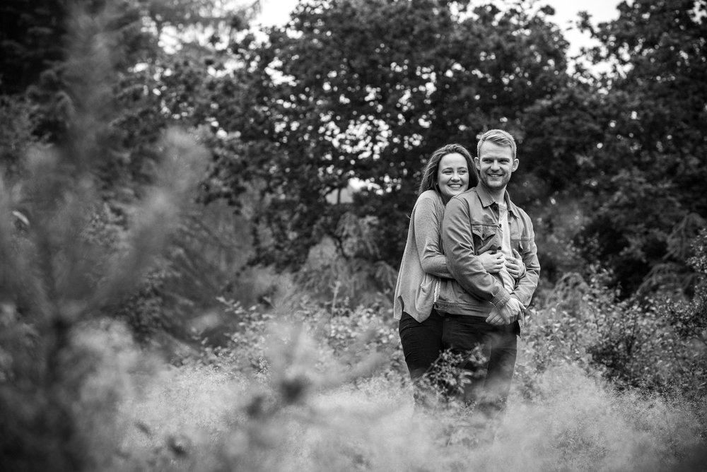 Real emotion, couple hugging in engagement shoot photography © Jessica Grace Photography