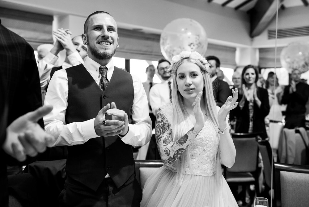 Black and white photograph of couple reacting to speeches © Jessica Grace Photography