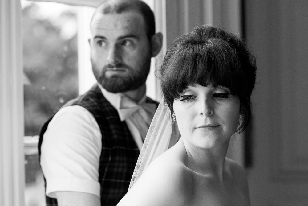 Elegant black and white wedding portrait with Whirling Turban Bride bride with elbow length veil and groom wearing  alternative tartan suit by ASOS © Jessica Grace Photography