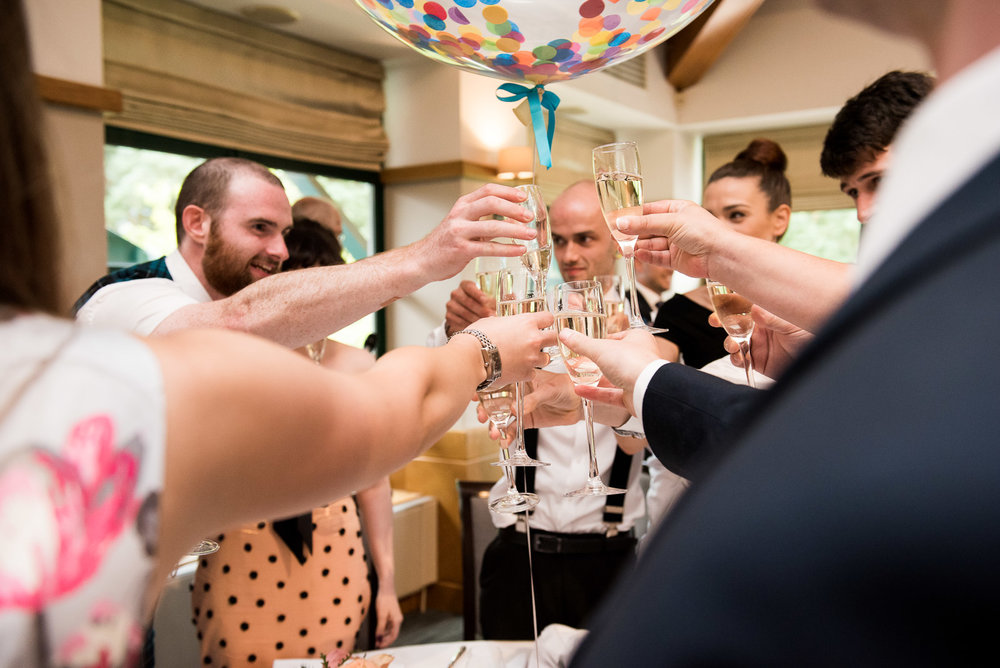 Champagne toast at alternative Camberley Heath wedding. Surrey Wedding Photographer © Jessica Grace Photography