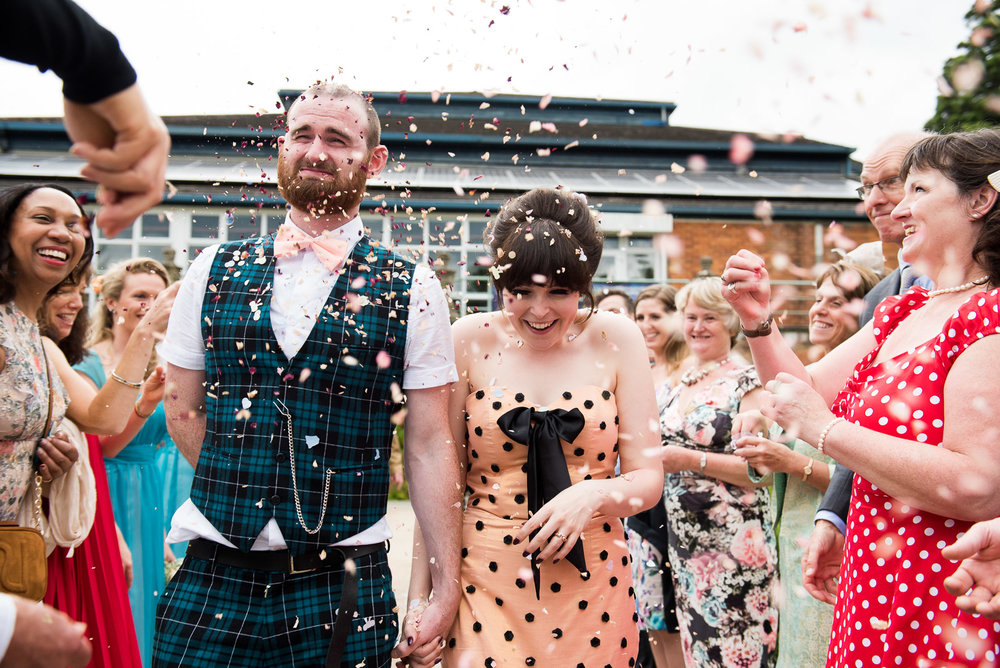 Captured Moment - laughing during confetti line at a summer wedding at Wilde Theatre, Surrey © Jessica Grace Photography