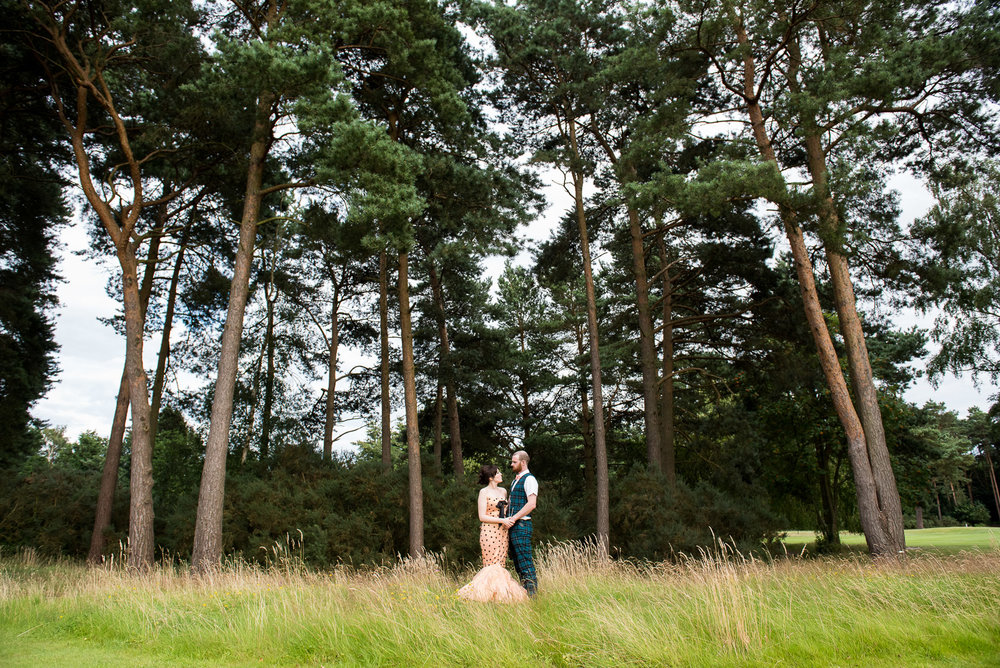 Bride and groom embrace in the beautiful grounds at Camberley Heath Golf Club, Surrey © Jessica Grace Photography