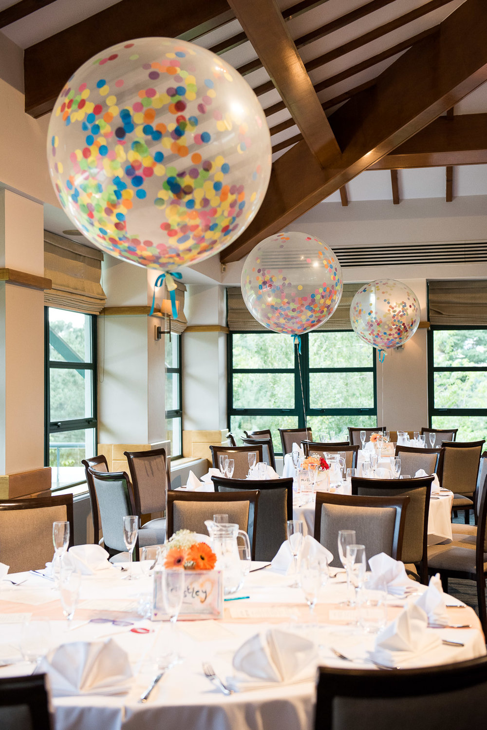 Confetti filled balloons for alternative wedding at Camberley Heath Golf Club © Jessica Grace Photography