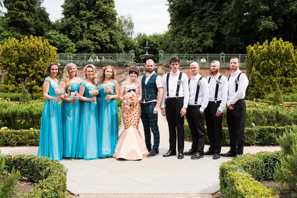 The bridal party outside in the sunshine at beautiful wedding venue in Surrey - Wilde Theatre © Jessica Grace Photography
