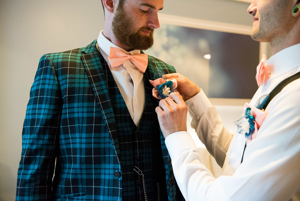 Relaxed groom wearing an ASOS tartan suit for an Surrey wedding © Jessica Grace Photography