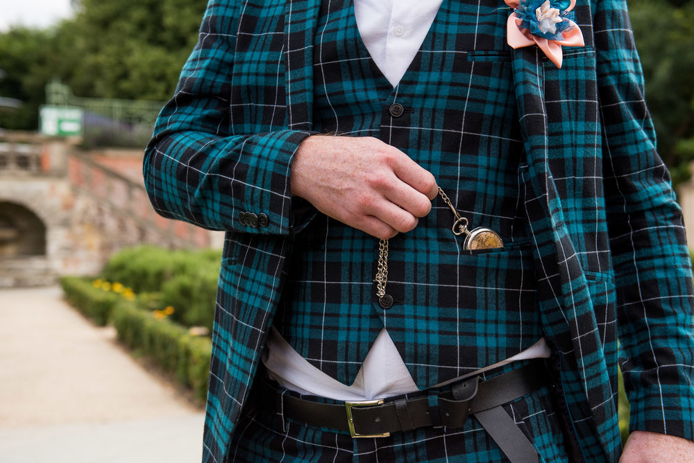 Groom detail photograph - wearing a tartan suit from ASOS with a vintage pocket watch © Jessica Grace Photography