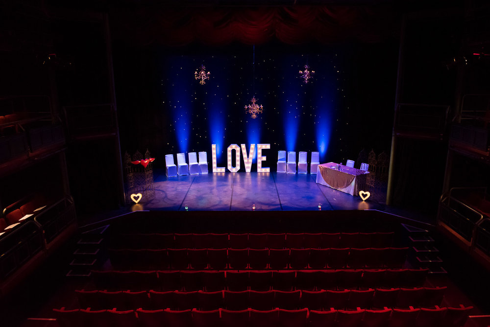 Creative LOVE letter sign for alternative wedding on a theatre stage, Surrey © Jessica Grace Photography