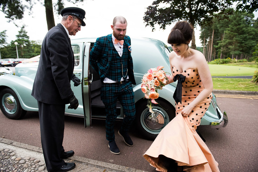 Bride and groom arriving in their vintage wedding car, beautiful custom made wedding dress by Whirling turban and tartan suit by ASOS  © Jessica Grace Photography