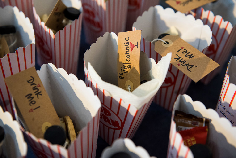 Handmade DIY popcorn box wedding favours for an alternative wedding in a Theatre, Surrey © Jessica Grace Photography