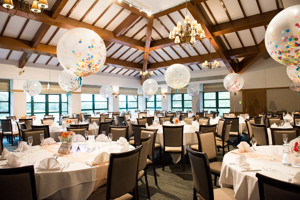 Fun and colourful wedding reception at Camberley Heath Golf Club with over sized balloons  © Jessica Grace Photography