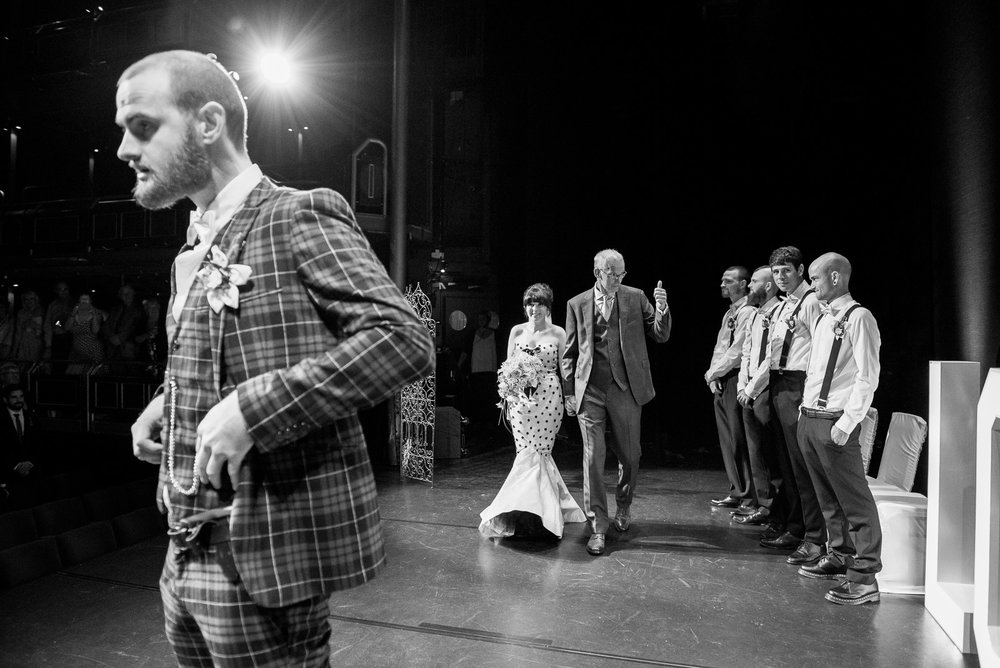 Arriving on stage to be married in a theatre © Jessica Grace Photography.jpg