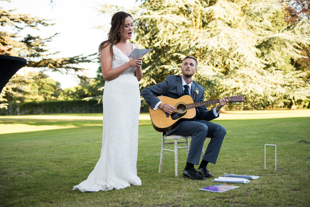 Beautiful bride singing her speech outside at Loseley Park, Surrey © Jessica Grace Photography.jpg