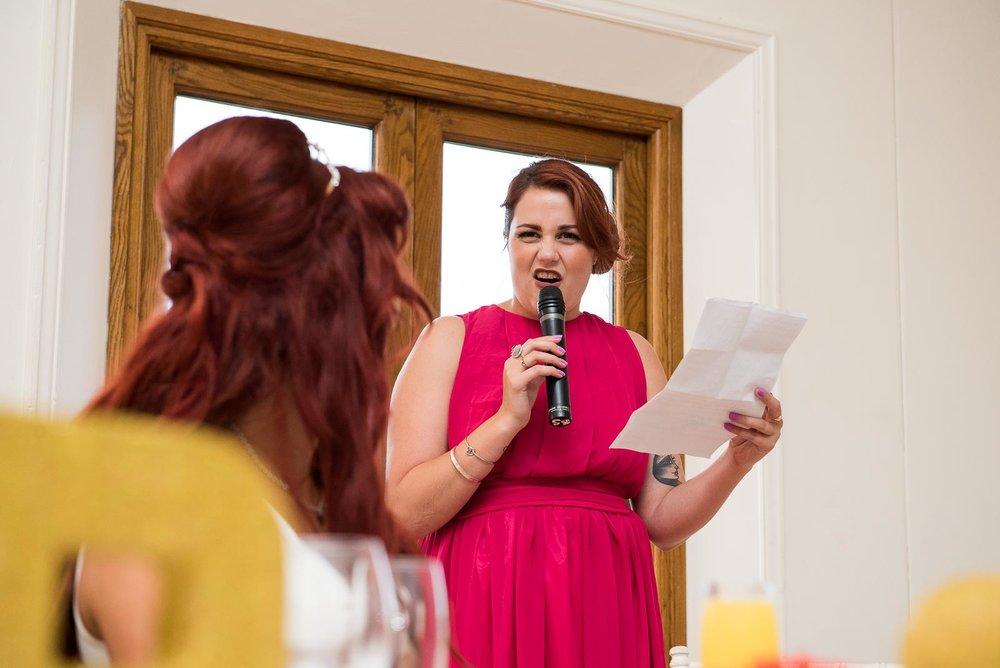 Beautiful maid of honor giving a wedding speech © Jessica Grace Photography.jpg