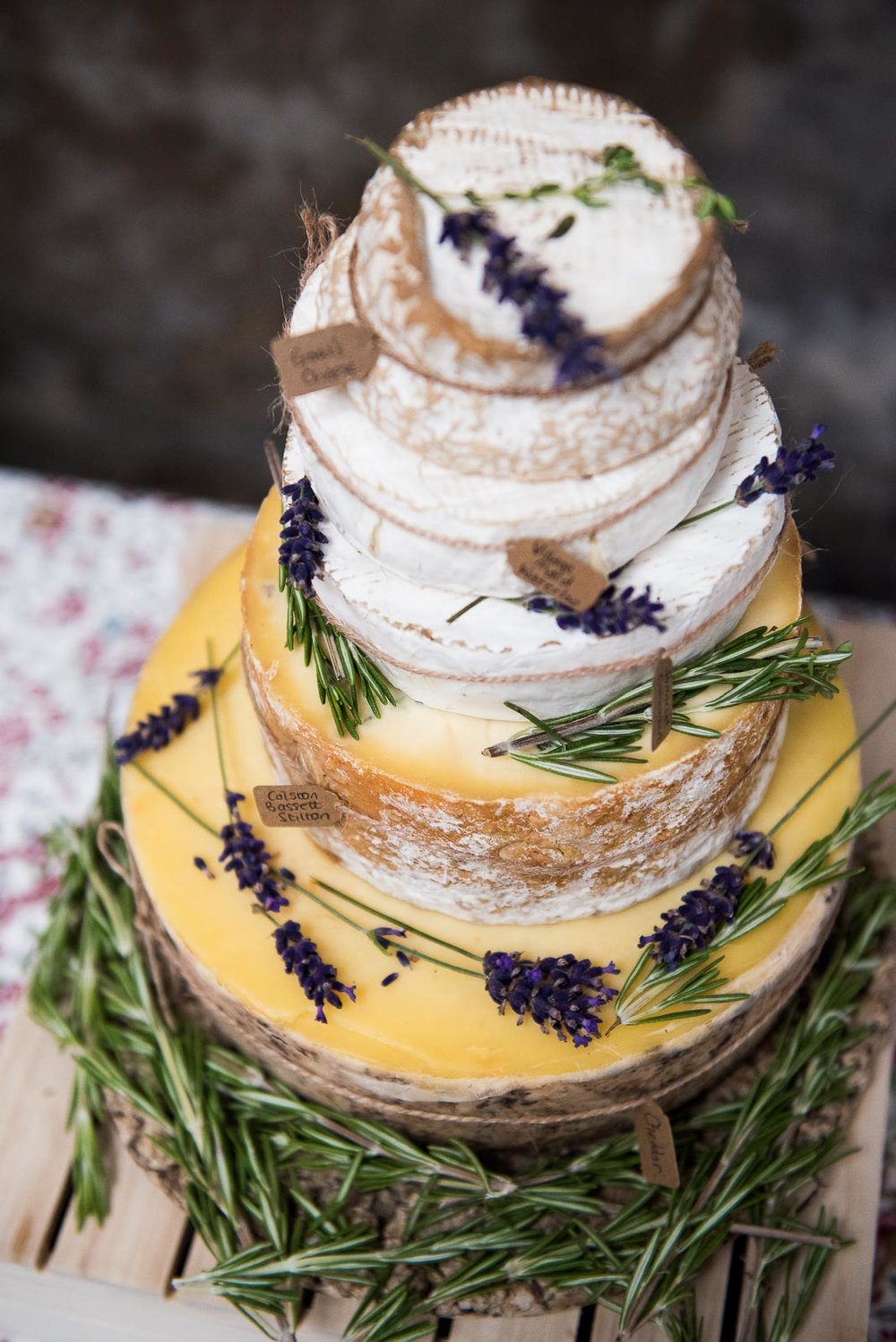 A wedding cake made out of cheese wheels © Jessica Grace Photography