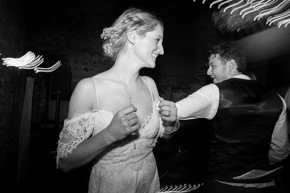 Black and white photograph of the bride and groom dancing to ceilidh band © Jessica Grace Photography