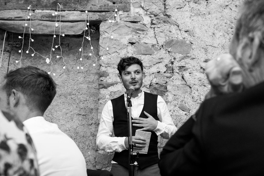 Black and white photograph of groom making a speech © Jessica Grace Photography