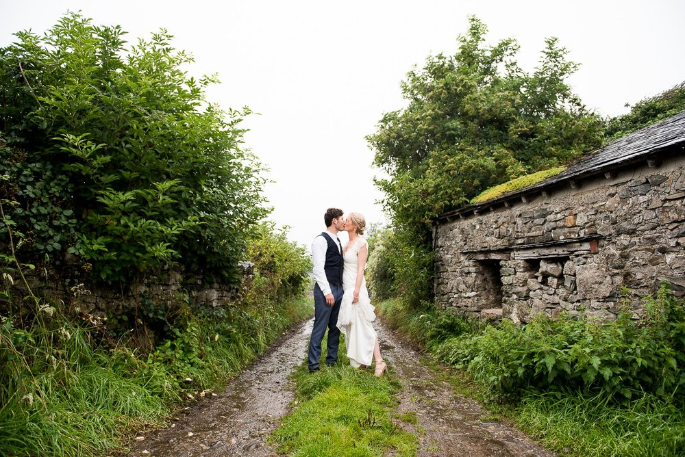 Bride and groom embrace in the rain, Lake District wedding © Jessica Grace Photography