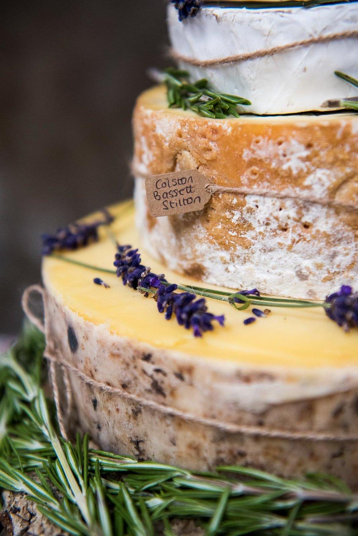 Creative wedding ideas, a cheese wheel wedding cake © Jessica Grace Photography