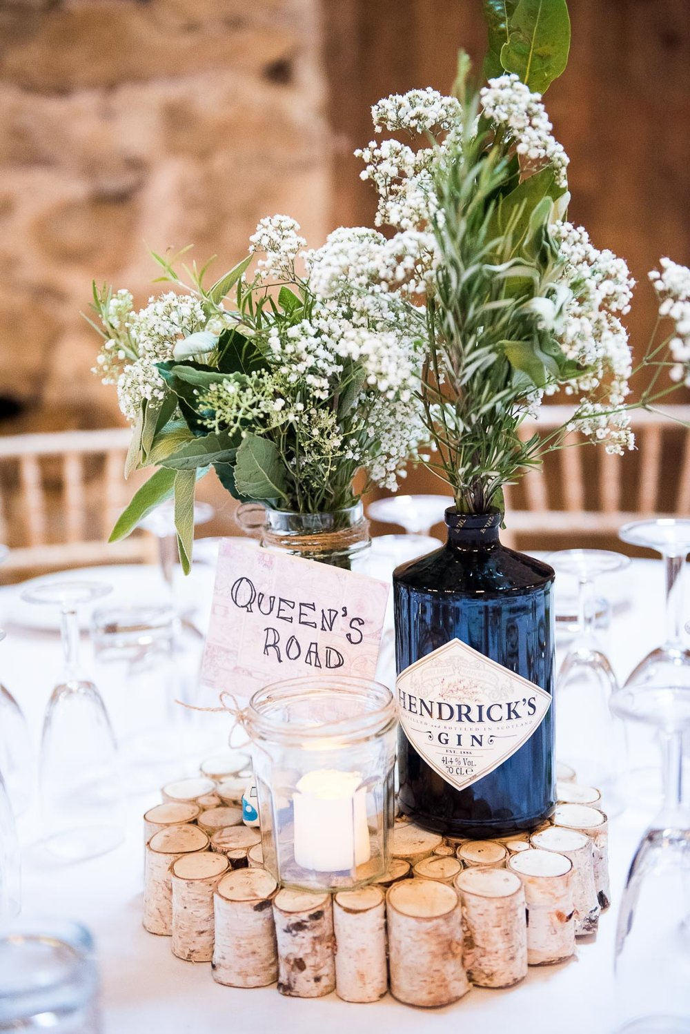 DIY gin bottle vase with gorgeous green florals © Jessica Grace Photography