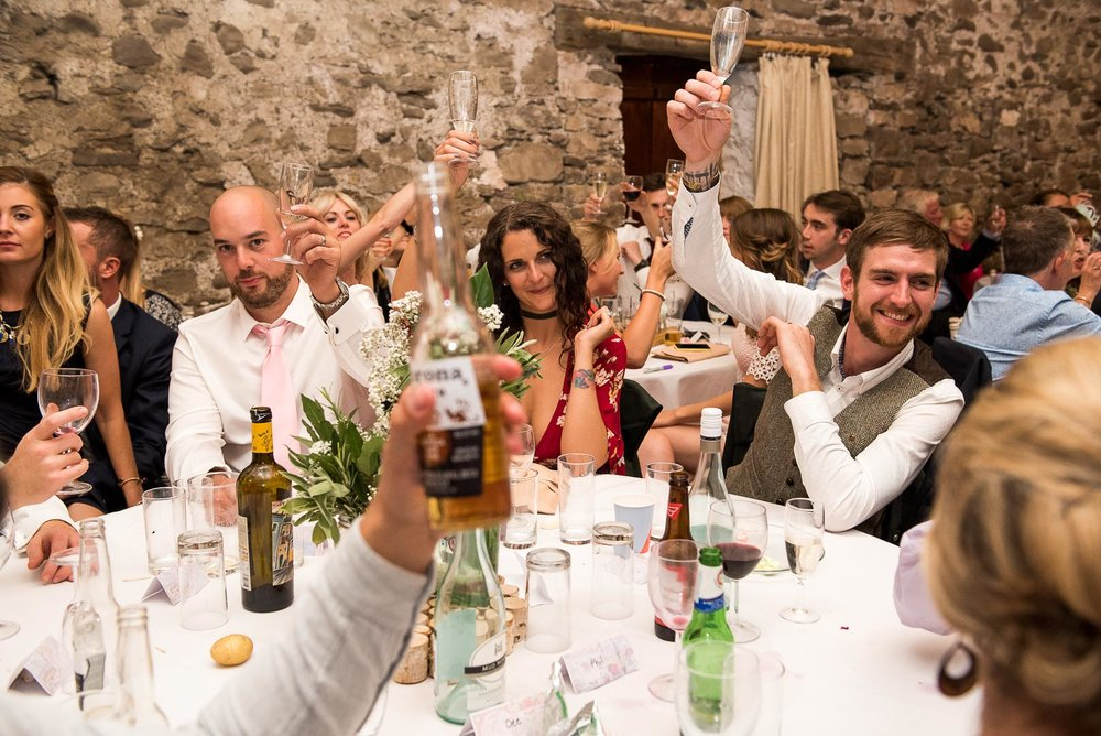 Guests raise a glass to the happy couple © Jessica Grace Photography