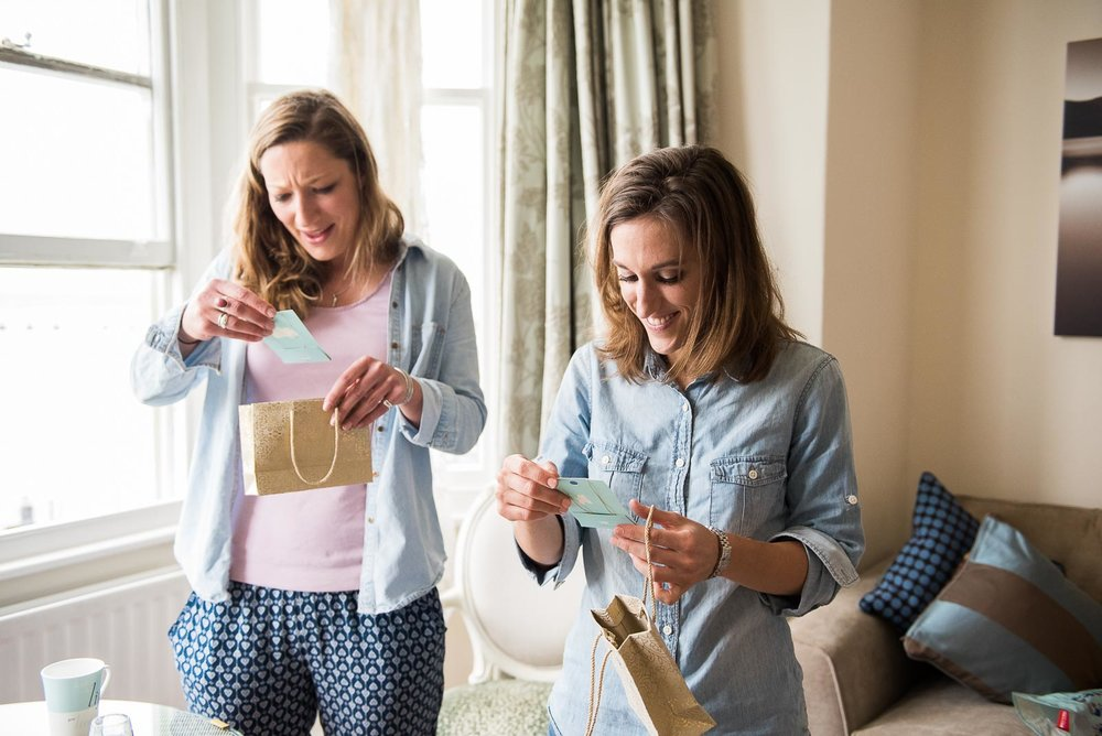 Gorgeous moment where the bridesmaids open their gifts from the bride © Jessica Grace Photography