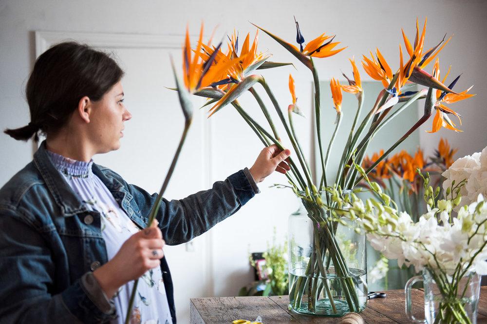 Essex wedding florist arranging exotic flowers © Jessica Grace Photography
