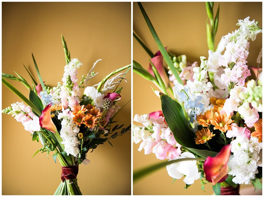 Stunning mixed bloom bouquest on a mustard back drop © Jessica Grace Photography