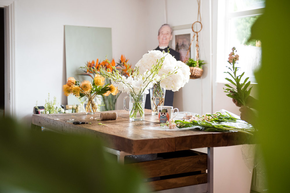 Work bench filled with vases and flowers © Jessica Grace Photography